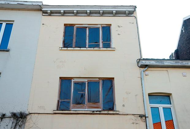 Damaged windows of an apartment are pictured in the Brussels district of Forest where a gunman was shot dead by Belgian police on Tuesday after a raid on the apartment linked to investigations into November's Islamist attacks in Paris March 16, 2016