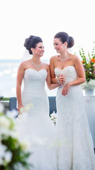 A vision in white: Eleni (left) and Maryann on their wedding day.