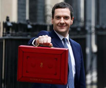 Britain's Chancellor of the Exchequer, George Osborne, holds up his budget case for the cameras as he stands outside number 11 Downing Street