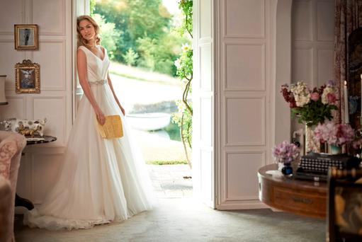 Stephanie Allin's 'Charlotte' dress was named after the arrival of Princess Charlotte. This silk and duchesse satin dress features a full circle silk organza layered skirt, €4,300. Worn here with the 'Serena' belt, priced separately.