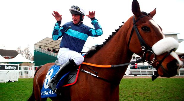 Davy Russell celebrates on board Diamond King after winning the the Coral Cup