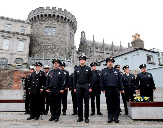 Members of the Berkeley, Oakland and Fremont police and fire departments at the garda memorial in Dublin Castle. Photo: Tom Burke