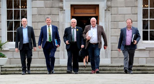 Independent deputies, from left, Denis Naughten, Dr Michael Harty, Mattie McGrath, Noel Grealish and Michael Collins who met with the Fianna Fáil negotiators at Leinster House yesterday. Photo Tom Burke