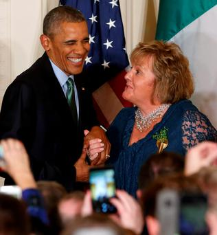 US President Barack Obama laughs with the Taoiseach's wife Fionnuala Kenny during a St Patrick's Day reception at the White House. Photo: Reuters