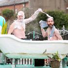 Charlie Jacob (left) and Nicholas Kavanagh, from the Waterford Spraoi Street and Spectacle Company, make final preperations to their float. Photo: Robbie Reynolds