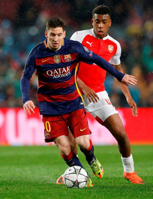 Barcelona's Lionel Messi tries to evade Arsenal's Alex Iwobi. Photo: Carl Recine/Action Images via Reuters