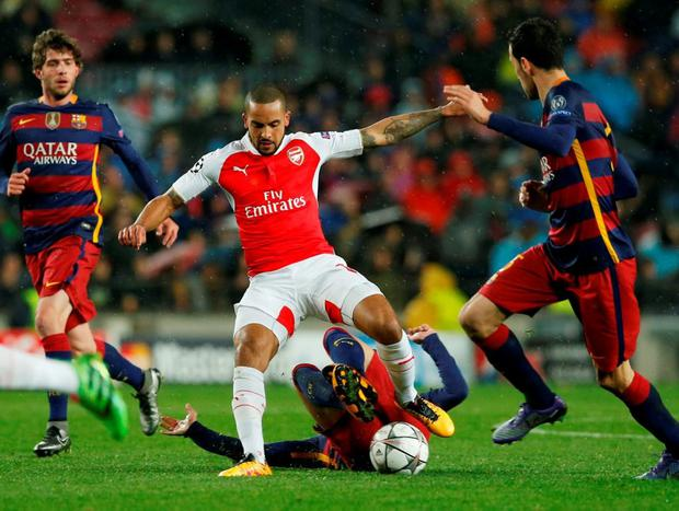 Arsenal's Theo Walcott tries to keep possession. Photo: Albert Gea/Reuters