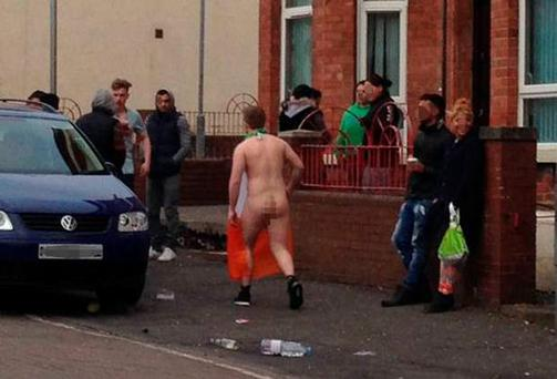 A naked man is pictured wearing a Tricolour in the Holylands. Picture: BBC reporter Claire Graham @JournoClaire