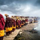 Christopher Roche, Winner, Ireland, National Award, 2016 Sony World Photography Awards' 'The great prayer festival of Monlam takes place in eastern Tibet during the heart of winter. Tens of thousands of pilgrims join the monks in celebrating the event. Here the monks of Taktsang Lhamo are performing the ritual known as the 'Turning of the Buddha' where a statue of the Maitreya Buddha is carried around the four corners of the village. Maitreya is a Buddha who will appear on Earth in the future, achieve complete enlightenment and then teach the dharma. This ceremony is to ensure that the earthly realm will be ready for his arrival.'