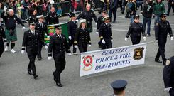 Members of the Berkeley Police and Fire departments march in the 2016 Dublin St Patrick's Day Parade