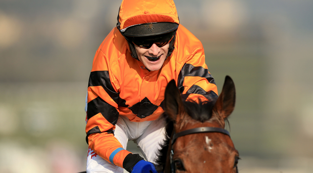 Jockey Tom Scudamore celebrates winning the Ryanair World Hurdle on Thistlecrack during St Patrick's Thursday of the 2016 Cheltenham Festival at Cheltenham Racecourse. PRESS ASSOCIATION Photo. Picture date: Thursday March 17, 2016. See PA story RACING World. Photo credit should read: Mike Egerton/PA Wire. RESTRICTIONS: Editorial Use only, commercial use is subject to prior permission from The Jockey Club/Cheltenham Racecourse. Call +44 (0)1158 447447 for further information.