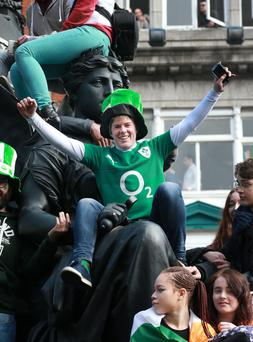 Josh Mc Grath, Dunboyne gets a bird's-eye view of the St Patrick's Festival Parade from the Daniel O' Connell monument in Dublin. Photo : Frank Mc Grath