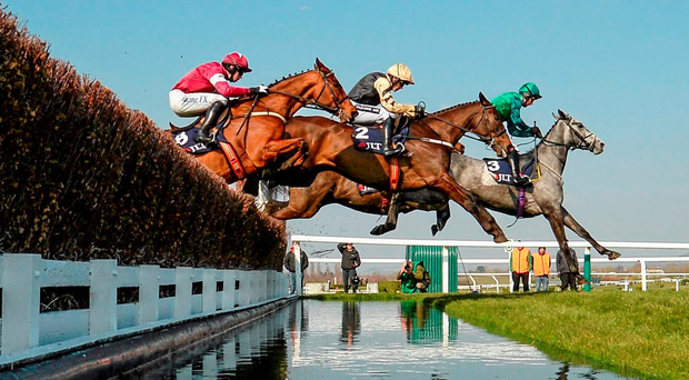 Black Hercules, with Ruby Walsh up (centre) jumps the water jump between Bristol De Mai, with Daryl Jacob up (front) and Outlander (Bryan Cooper) on the way to winning the JLT Novices' Steeplechase Photo: Sportsfile