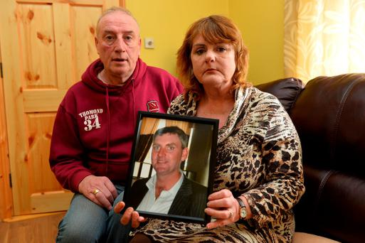 Bridie Curtin from Lyreacrompane, Duagh, Listowel, Co Kerry, holds a photo of her dead son, Eamon. Also in the picture is her partner Mike Carmody. Photo: Domnick Walsh