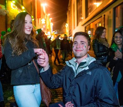 Matt Miller from Texas proposes to girlfriend Sarah Conn, Ballinteer at the St Patrick's Day festivities in Temple Bar, Dublin. Photo: Arthur Carron