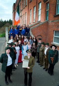 Shauna Sheridan of St Mary's Holy Faith Convent Secondary School plays Padraig Pearse as the Glasnevin school's students enact a reading of the Proclamation of Independence. Photo: Colin O'Riordan