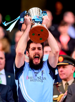 Cathal King lifts the Tommy Moore Cup (SPORTSFILE)
