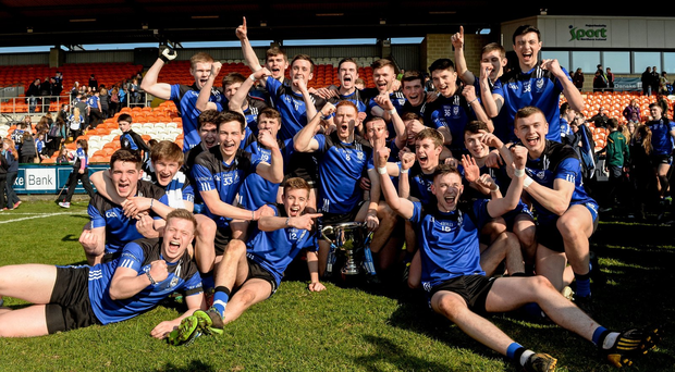 The St Patrick's College Maghera squad celebrate with the McRory Cup (SPORTSFILE)