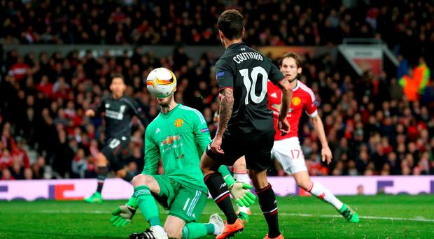 Liverpool's Philippe Coutinho lifts the ball over David De Gea to score his team's goal at Old Trafford Photo: Martin Rickett/PA Wire