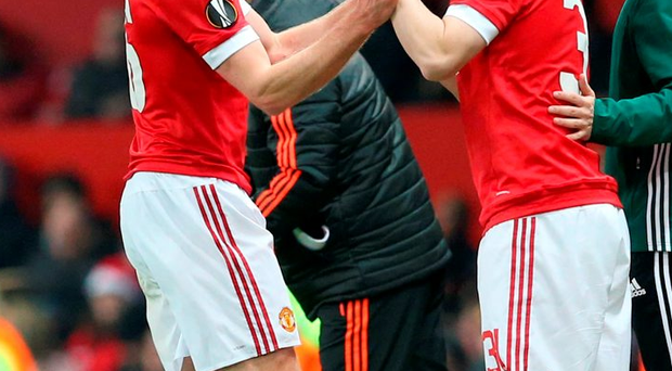 Manchester United's Michael Carrick (left) is substituted for teammate Bastian Schweinsteiger Photo: PA Wire