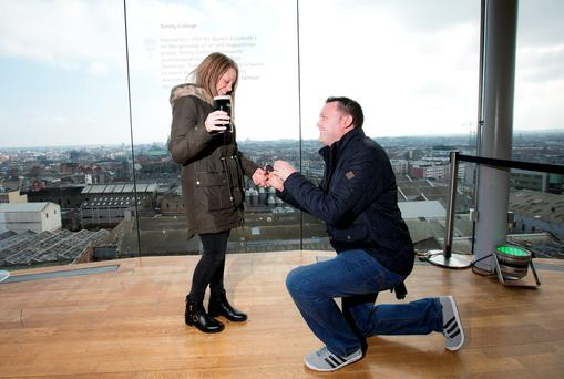 Nathan Hilton from Nottingham England surprises Emma Daly by proposing at the Guinness Storehouse Photo: Andres Poveda
