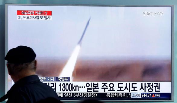 A man watches a TV screen showing a file footage of the missile launch conducted by North Korea (AP Photo/Ahn Young-joon)