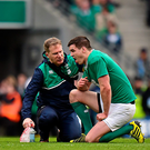 Ireland's Jonathan Sexton recieves medical attention after picking up an injury against Italy