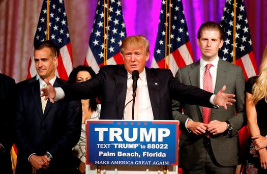 Republican U.S. presidential candidate Donald Trump stands between his campaign manager Corey Lewandowski (L) and his son Eric (R) REUTERS/Joe Skipper