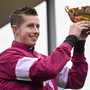 18 March 2016; Bryan Cooper celebrates with the Gold Cup after winning the Timico Cheltenham Gold Cup Steeple Chase on Don Cossack. Prestbury Park, Cheltenham, Gloucestershire, England. Picture credit: Cody Glenn / SPORTSFILE