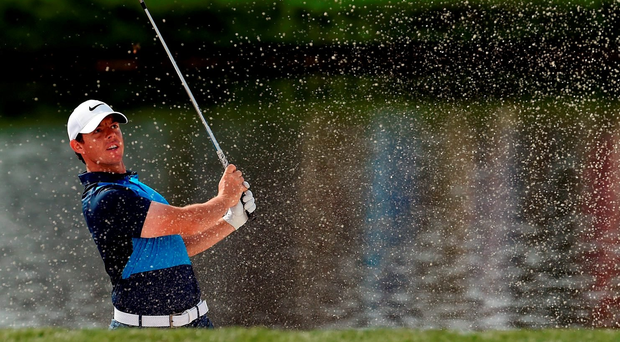 ORLANDO, FL - MARCH 18: Rory McIlroy of Northern Ireland hits from a green side bunker on the 17th hole during the second round of the Arnold Palmer Invitational Presented by MasterCard at Bay Hill Club and Lodge on March 18, 2016 in Orlando, Florida. (Photo by Stacy Revere/Getty Images)