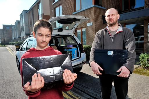 Jabor Ringhoffer and his son Alex (12) pictured moving out of their apartment in Residents of Eden, Blackrock, Cork. Photo: Daragh Mc Sweeney