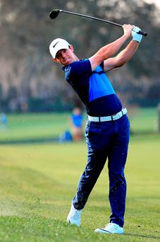 Rory McIlroy hits his approach shot at the 12th hole at Bay Hill. Photo: Getty