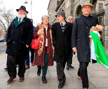 Proinsias O'Rathaille, grandson of 'The O'Rahilly', Helen Litton, a great niece of Tom Clarke, James Connolly Heron, a great grandson of James Connolly, and Patrick Cooney, a founder member of the Save 16 Moore Street committee, leave court yesterday after the hearing. Photo: Courtpix