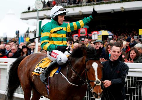 Barry Geraghty on Ivanovich Gorbatov celebrates winning the 1.30 JCB Triumph Hurdle race Photo: Reuters