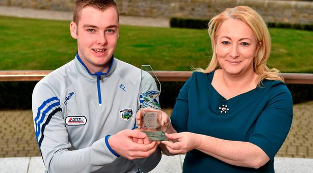 Laois U21 football captain Eoin Lowry is presented with the February's EirGrid Player of the Month award Rosemary Steen, Director of Public Affairs at EirGrid Photo: Sportsfile