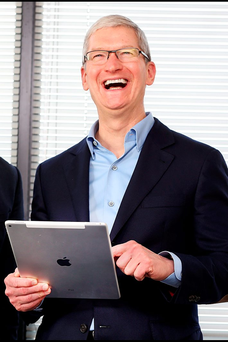 Apple CEO Tim Cook with a 13-inch iPad Pro. Photo: Steve Humphreys