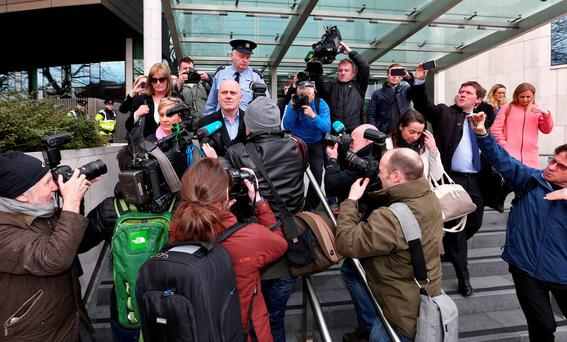 David Drumm leaving court on Tuesday with friends and family after he was granted bail. Photo: Colin Keegan