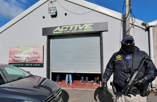 Gardai raiding a car sales business in Bluebell last week, in which 18 vehicles were seized