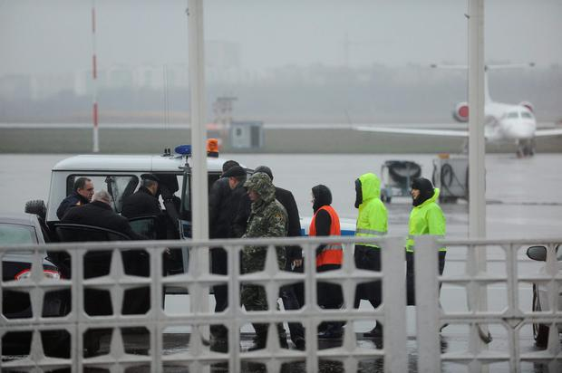 Russian Emergency Situations Ministry employees and police officers are seen as they take a car to drive to the area of a plane crash at the Rostov-on-Don airport, about 950 kilometers (600 miles) south of Moscow, Russia Saturday, March 19, 2016