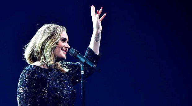 Adele performs on stage at The O2