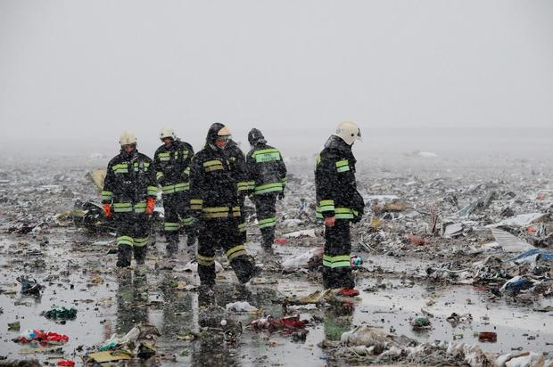 Russian Emergency Ministry employees are seen in the snow among the wreckage of a crashed plane at the Rostov-on-Don airport, about 950 kilometers (600 miles) south of Moscow, Russia Saturday, March 19, 2016