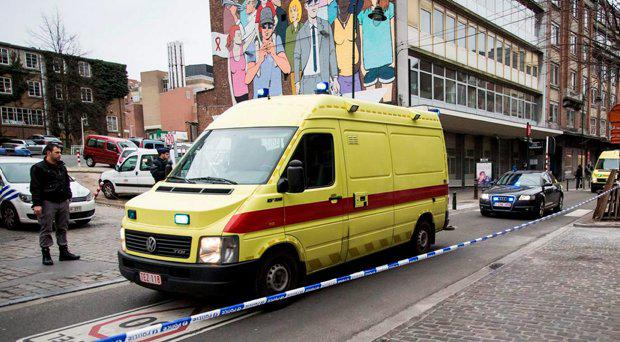 An ambulance leaves Saint-Pierre hospital in Brussels accompanied by a police convoy