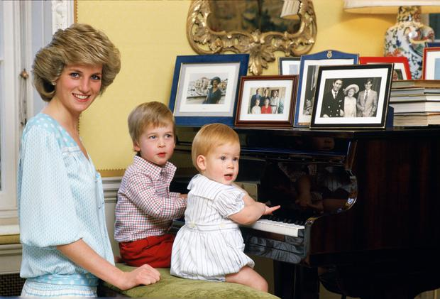 Diana, Princess of Wales with her sons, Prince William and Prince Harry, at the piano in Kensington Palace