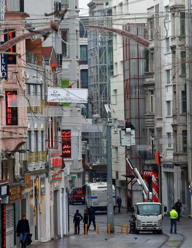 Police officers check security surveillance cameras on Istikal street, following a suicide bombing in a major shopping and tourist district in central Istanbul REUTERS/Osman Orsal