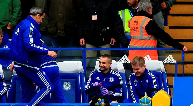 Chelsea physio Jon Fearn (centre right) returns to the bench before the Barclays Premier League match at Stamford Bridge
