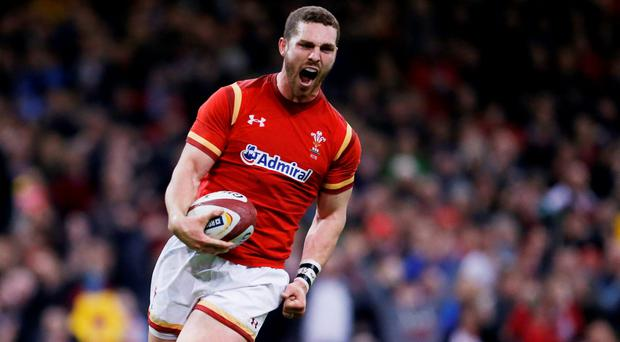 Wales George North celebrates scoring a try