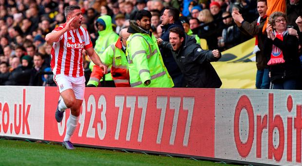 Stoke City's Jonathan Walters celebrates scoring his side's first goal of the game during the Barclays Premier League match at Vicarage Road