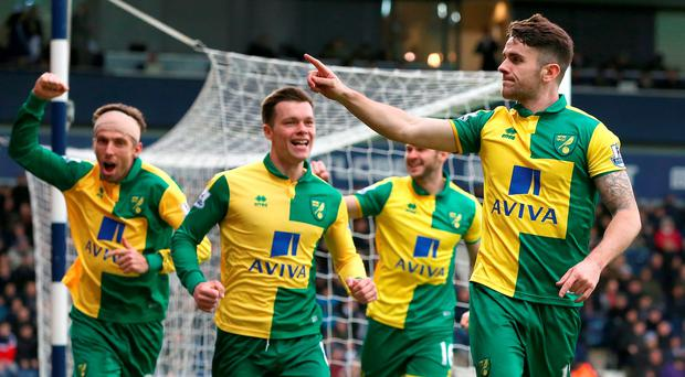 Norwich City's Robbie Brady celebrates scoring his side's first goal of the game during the Barclays Premier League match at The Hawthorns