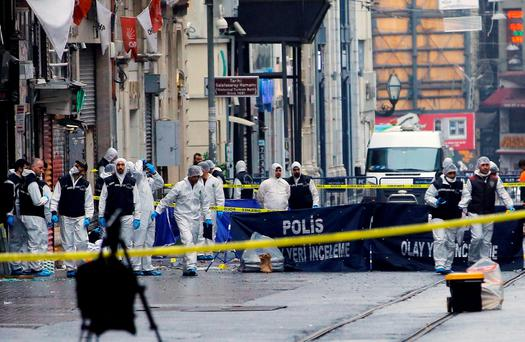 Police forensic experts inspect the area after a suicide bombing in a major shopping and tourist district in central Istanbul, Turkey REUTERS/Huseyin Aldemir
