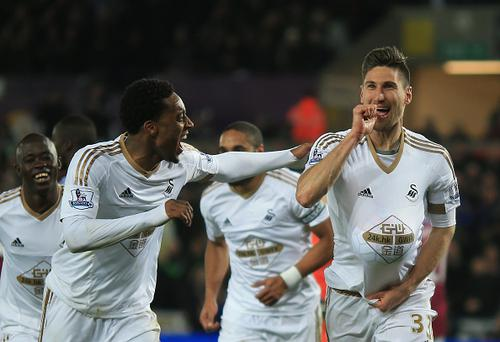 SWANSEA, WALES - MARCH 19: Federico Fernandez (R) of Swansea City celebrates scoring his team's first goal with his team mate Leroy Fer (L) during the Barclays Premier League match between Swansea City and Aston Villa at Liberty Stadium on March 19, 2016 in Swansea, United Kingdom. (Photo by Ben Hoskins/Getty Images)